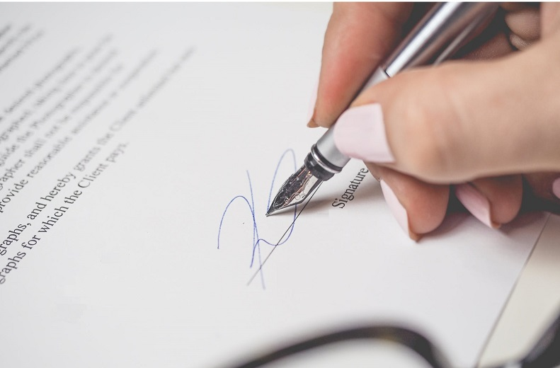 Hand signing contract with fountain pen